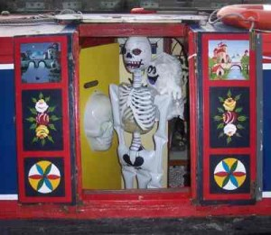 A skeleton gets ready to scare on the canal